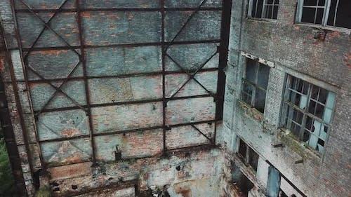 Flight over the destroyed factory. Old industrial building for demolition.