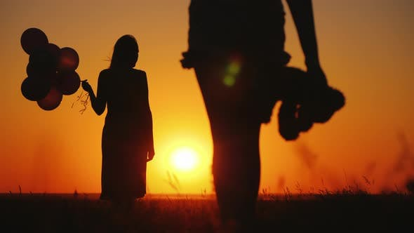 Thumbnail for Carefree Child with a Toy in Hand Runs To Mom at Sunset