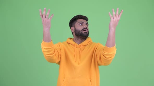 Thumbnail for Happy Young Overweight Bearded Indian Man Catching Something