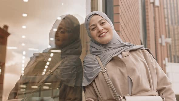 Arabic Woman Waving to Camera