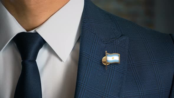 Thumbnail for Businessman Walking Towards Camera With Country Flag Pin   Argentina