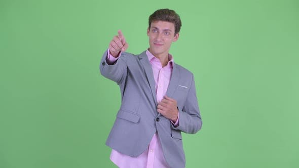 Cover Image for Happy Young Businessman Pointing Finger