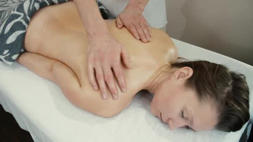 Therapist Giving Soothing Massage To a Woman