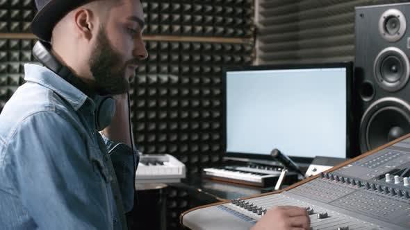 Thumbnail for Man Using Mixing Desk in Recording Studio