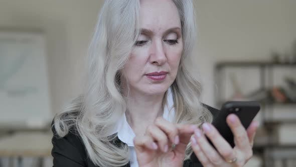 Thumbnail for Old Businesswoman Using Smartphone