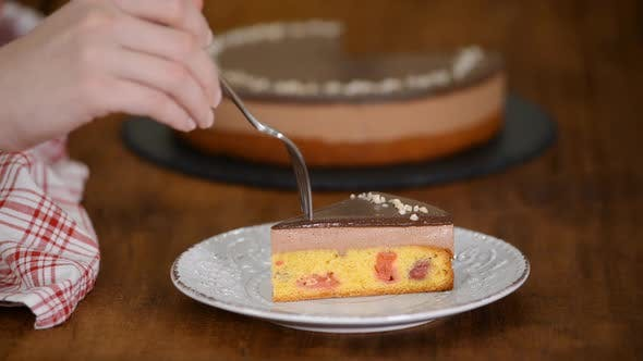Thumbnail for Eating piece of Chocolate Cherry Mousse Cake