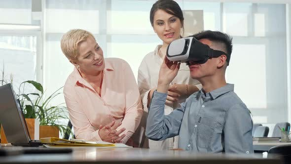 Thumbnail for Colleagues Watching Young Businessman Using 3d Vr Glasses
