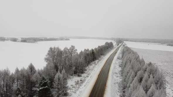 Aerial View of Passing Cars on a Winter Road