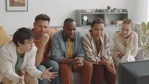 Multiethnic Men and Women Watching TV