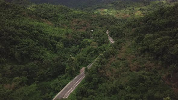 Thumbnail for Aerial View Of Countryside Road Passing Through The Mountain Landscape 06