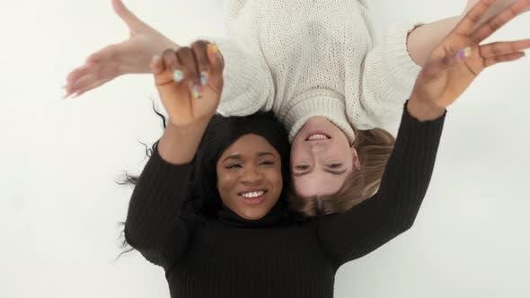 Two Mulri Racial Women Friends Posing and Having Fun at Studio
