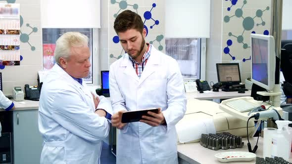 Thumbnail for Man Shows Something on Monitor To His Colleague at the Laboratory