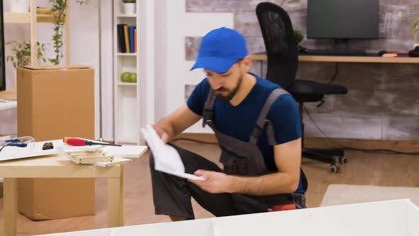 Thumbnail for Confused Furniture Assembly Worker While Reading Instructions