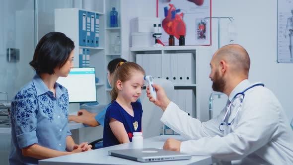 Pediatrician Checking Ontemperature