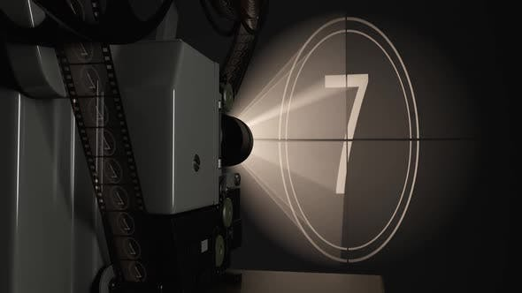 Movie Projector Against Cinema Screen and Light Rays Projected Video