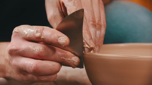 Thumbnail for Pottery - the Master Is Helping with a Special Spatula To Smooth the Surface of the Clay Bowl