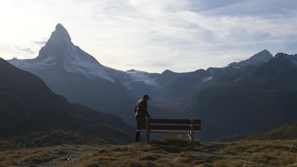 Cover Image for Picturesque View of Matterhorn Peak and Wooden Bench in Swiss Alps