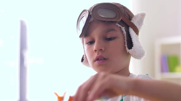Thumbnail for Boy in Pilot Hat Playing with Airplane Toy at Home 21