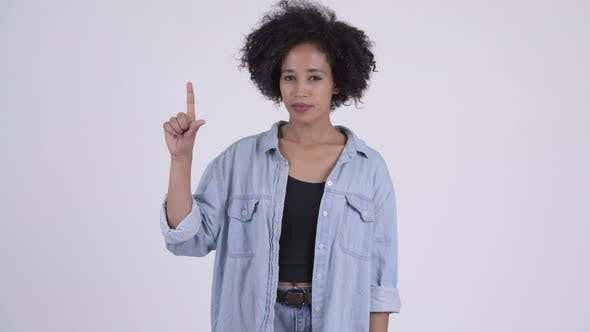 Thumbnail for Young Beautiful African Woman Pointing Up