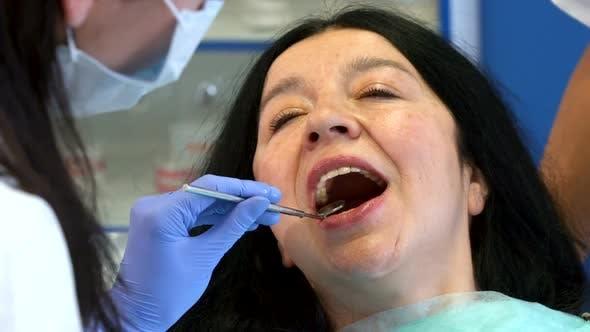 Thumbnail for Dentist Checks Up Woman's Teeth