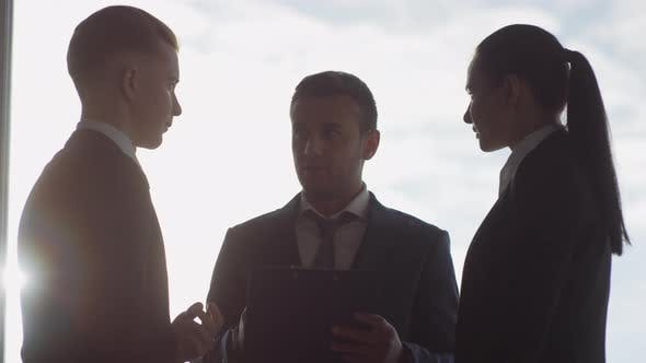 Thumbnail for Slowmo of Business Executives Discussing Work