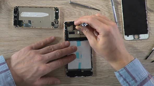 Thumbnail for Smartphone Specialist Repairing Gadget and Changing Microchip Technologies