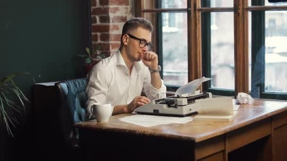 Thumbnail for Writer Having Coffee As Typing