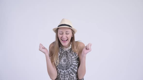 Cover Image for Portrait of Happy Blonde Tourist Woman Looking Surprised