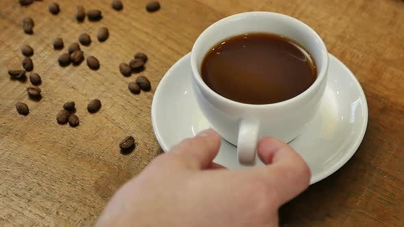 Thumbnail for Male Hand Takes Hot Coffee To Drink