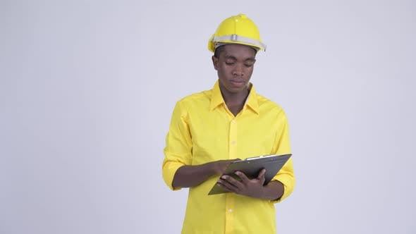 Thumbnail for Young Happy African Businessman As Engineer Directing While Holding Clipboard