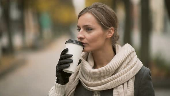 Thumbnail for Fashionable Woman Drinking Coffee Outdoor