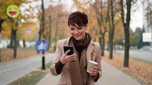 Thumbnail for A Woman Uses a Smartphone on the Street.
