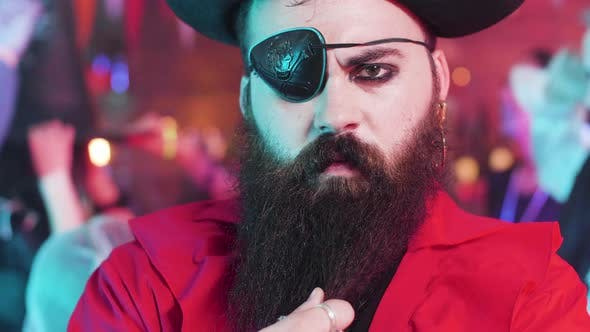 Thumbnail for Portrait of a Young Man Dressed in Pirate Costume with an Evil Look and Big Black Beard