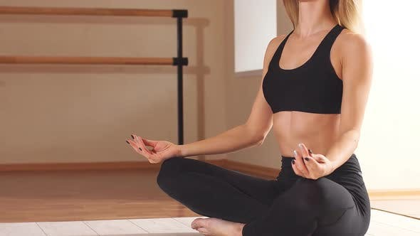 Young Attractive Woman Practicing Yoga.