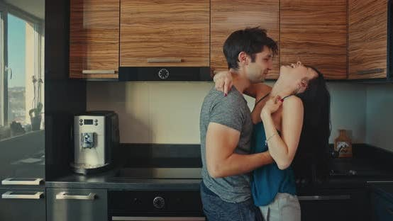 Cover Image for Offering Coffee to Husband in the Kitchen in the Morning