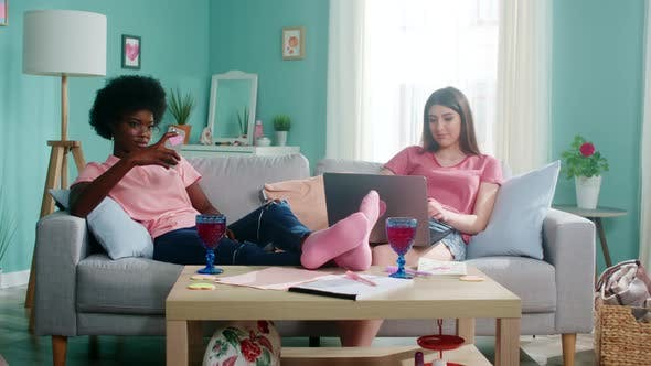 Thumbnail for Two Women Students Stay Home And Use Gadgets