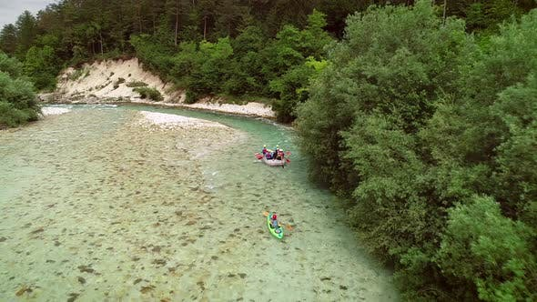 Aerial view of a group of people rafting on the Soca river, Slovenia.