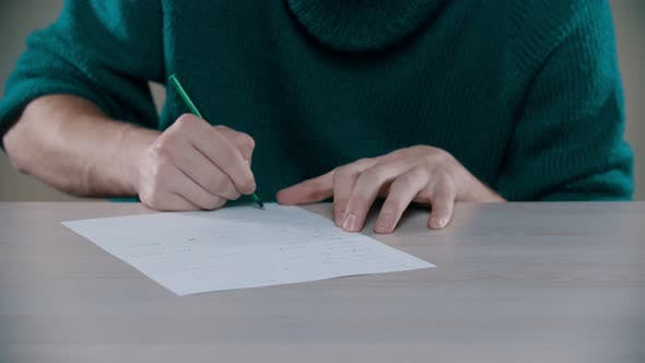 Thumbnail for A Man Is Actively Writing Word on a Paper and Crumplng It