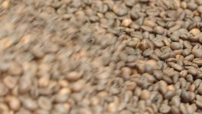 Closeup of Whole Coffee Beans on Roaster Machine