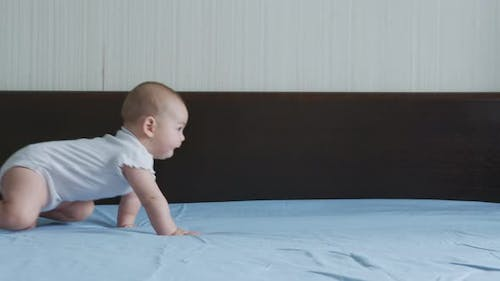 Happy Baby Girl Crawling on Bed Toddler Exploring Home Curious Infant Having Fun Enjoying Childhood