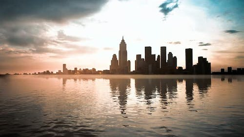 Skyline with Skyscrapers and Sea at Sunset