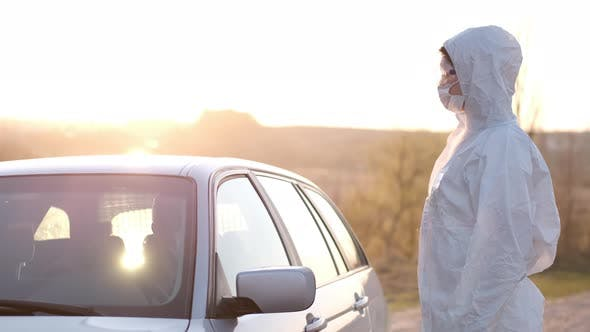 Thumbnail for A Woman in Full-coverage Equipment Is Stopping a Car at the Roadblock