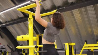 Woman Making Pullups Exercise