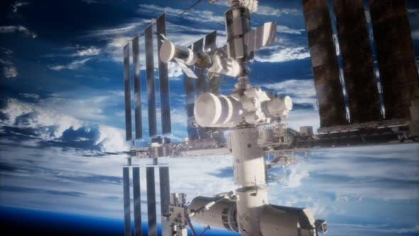 Thumbnail for A View of the Earth and a Spaceship. ISS Is Orbiting the Earth