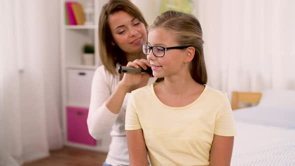 Thumbnail for Happy Mother Brushing Daughter Hair at Home 30