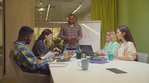 Businessman Motivating Team for Successful Work