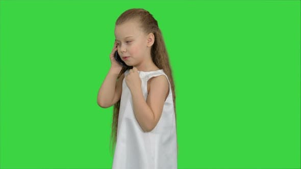 Thumbnail for Cute Little Girl Talking on the Cell Phone on a Green Screen, Chroma Key
