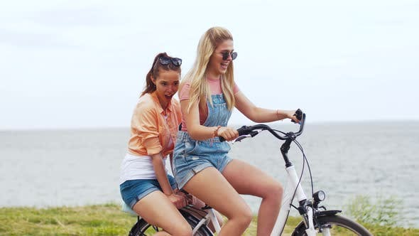 Thumbnail for Teenage Girls or Friends Riding Bicycle in Summer