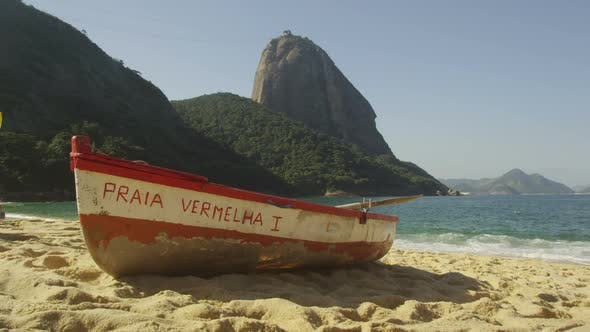 Thumbnail for Slow motion of a fishing skiff on Red Beach in Rio.