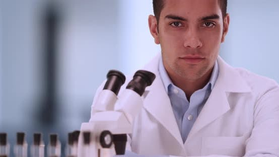 Thumbnail for Portrait of handsome millennial male scientist inside laboratory